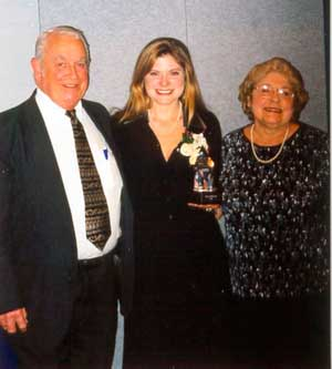 Dora with her Mom and Dad receiving the Governor's Award